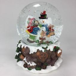 Bola de nieve con muñeco de nieve y oso