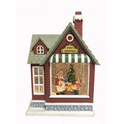 Christmas house with glitter globe