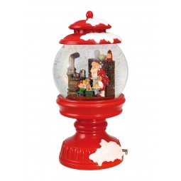 Snowglobe in a lantern shows Santa and his Elves baking