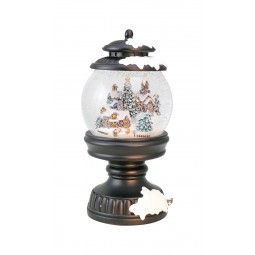Snowglobe in a lantern shows a Christmas town