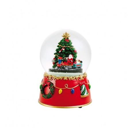 Bola de nieve con árbol de navidad y tren