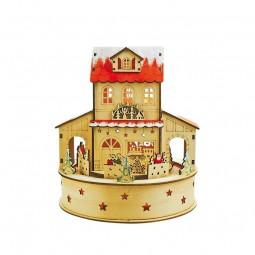 Casa de madera de Navidad iluminada