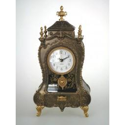 Reloj de chimenea de oro antiguo con cajón
