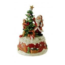 Papa Noel adornando el arbol