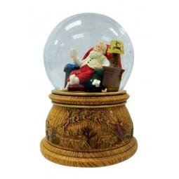 Bola de nieve Papa Noel sentado en su sillon
